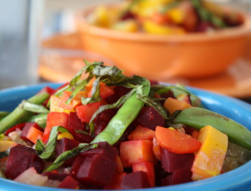 This bowl features steamed beets, sugar snap peas, carrots, summer squash, corn, and fresh basil.