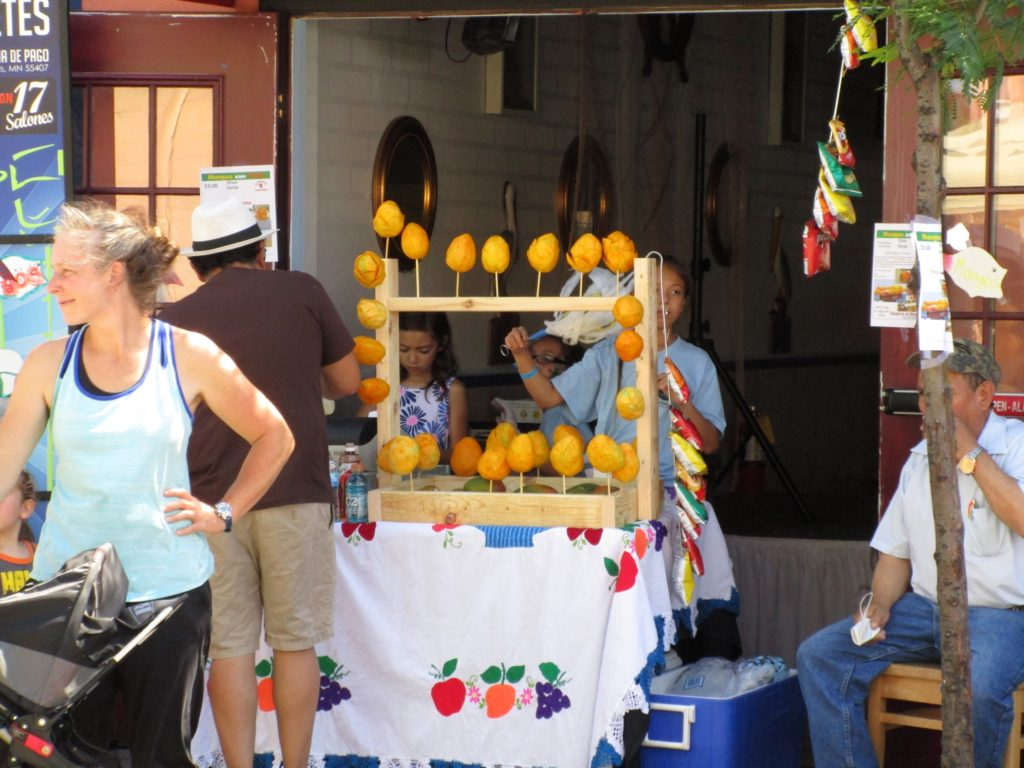 Grabbing a quick mango is a great plant-based street food option in summer.